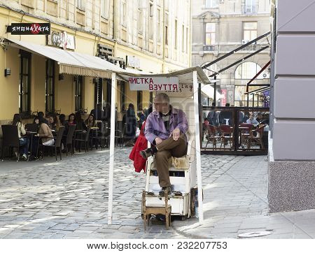 Lvov, Ukraine - April 01, 2017: Shoeshine Man Waiting For New Customer On Sity Street