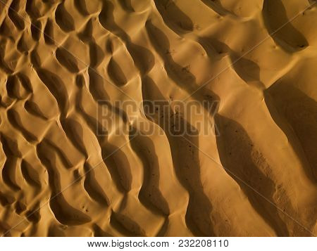 Aerial top view on sand dunes in Sahara desert, Africa