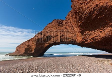 Legzira beach with arched rock on the Atlantic coast in Morocco