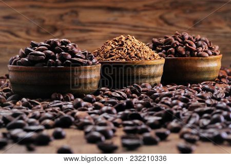 Coffee Beans Pile And Coffe Instant On The Background Of Ground Coffee