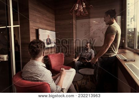 start up business people group attending videoconference call with senior investitior