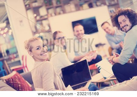 Group of a young business people discussing business plan at modern startup office building