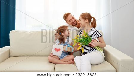 Happy Mother's Day! Father And Child Congratulate Mother On Holiday  .