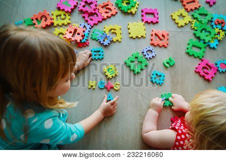 Kids Playing With Puzzle, Learning Numbers And Math