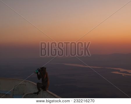 Hpa-an(pa An), Kayin State, Myanmar - February 5, 2017: Sunset View With Monkey Drinking Sprite Beve
