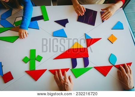 Teacher And Kids Play With Puzzle Or Tangram, Education And Learning
