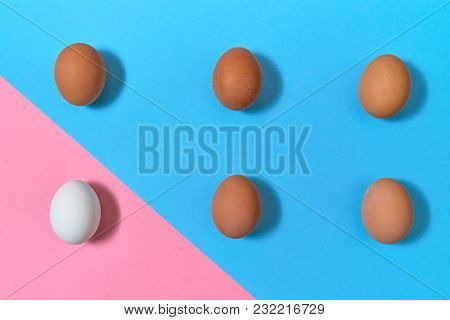 Eggs On Blue And Pink Pastel Background, Copy Space. Eggs On Paper Background With Two Tone Color. E