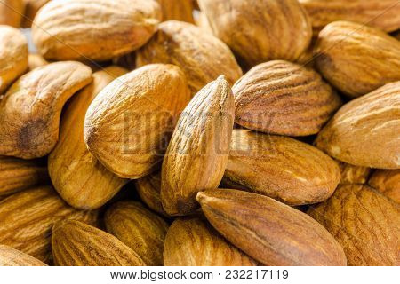 Close Up Of A Pile Of Salted Almonds, Selective Focus