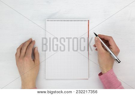Female Hands With A Blank Spiral Bound Notepad And Pen Ready To Write Notes In A Communications Or B