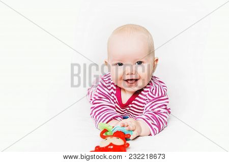 Smiling Cutest Baby Playing With Colorful Toys On A White Background. Happy 6 Months Old Baby Child