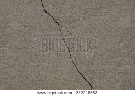 Concrete Gray Texture With A Crack On The Old Foundation