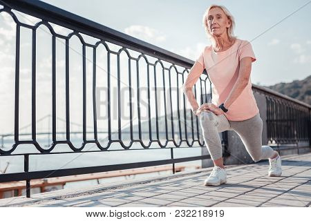 Sport Is My Choice. Senior Sporting Gray Haired Woman Spending Time On Fresh Air Stretching Legs And