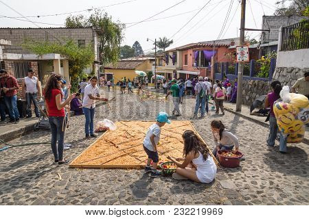Antigua, Guatemala: March 18 2018: Family Working On Alfombres, Carpets Made By Coloured Sawdust On