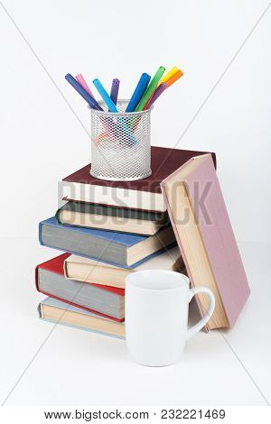Open Book, Hardback Colorful Books On Wooden Table, White Background. Back To School. Pens, Pencils,