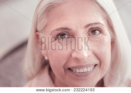 Look In My Eyes. Happy Aged Grey Haired Woman Looking Straight Smiling And Feeling Good Herself.