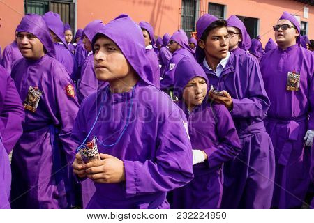 Antigua, Guatemala: March 18 2018: Young Purple Robed Men Cueing At The Procession Of San Bartolome