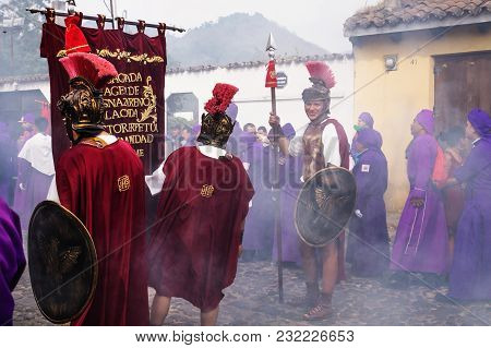 Antigua, Guatemala: March 18 2018: Man With Roman Soldier Smiling At The Procession Of San Bartolome