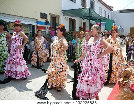 Alora, Spain - May 08, 2010: Flamenco Dancers In Traditional Dresses In Street Of Andalusian Village