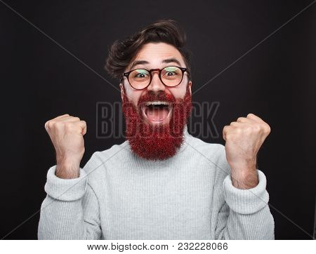 Portrait Of Handsome Hipster Guy With Red Dusted Beard Looking Excitedly At Camera.