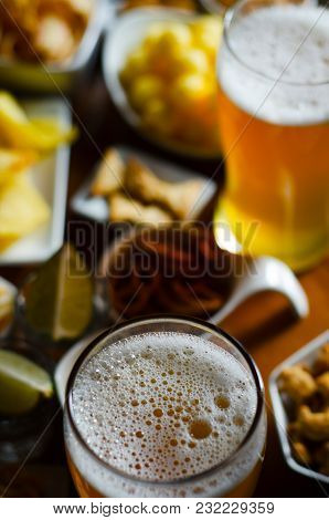 Pint Of Lager Beer In A Glass, Set Of Various Snacks, A Standard Set Of Drinking And Eating In A Pub