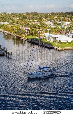 Sailboat Motoring Down Intercoastal Waterway In Fort Lauderdale