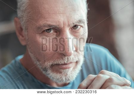 In My Eyes. Thoughtful Serious Aged Man Spending Time Alone Thinking And Looking Straight.