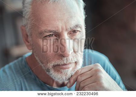 My Life My Mistakes. Concentrated Serious Aged Man Touching To His Chin Looking Aside And Thinking.