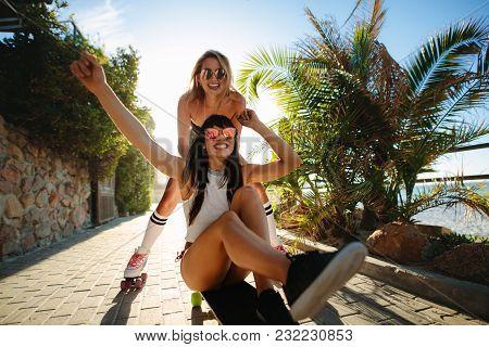 Two Women On Vacation Enjoying Skating