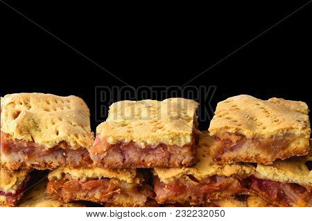 Pieces Of Homemade Apple Pie Laid Out With A Slide On A Black Background