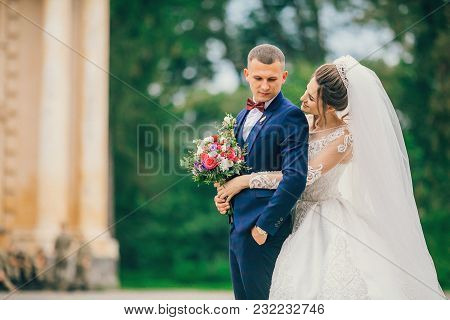 Sensual Portrait Of A Young Couple. Wedding Photo Outdoor. Newlyweds Bride And Groom At A Wedding In
