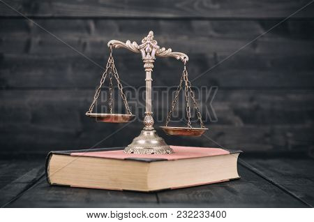 Law And Justice, Legality Concept, Scales Of Justice And Law Book On A Wooden Background.