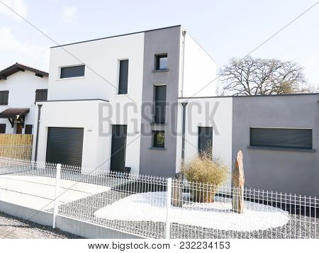 Modern House With Gray White Facade On The Sky Background Exterior View