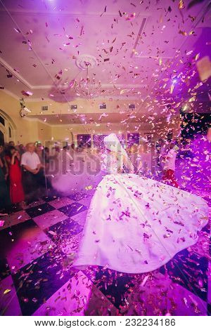 Amazing First Wedding Dance Of Newlywed With Different Colorful Light And Heavy Smoke On Restaurant.