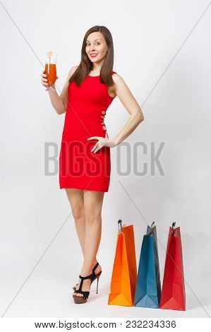 Full Length Attractive Glamour Young Woman In Red Dress Holding Glass Of Drink Cocktail, Multi Color