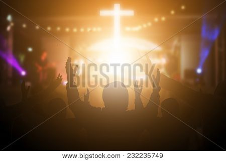 Christians Raising Their Hands In Praise And Worship At A Night Music Concert. Eucharist Therapy Ble