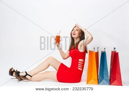 Attractive Sexy Glamour Young Woman In Red Dress Sitting With Glass Of Drink Cocktail, Multi Colored