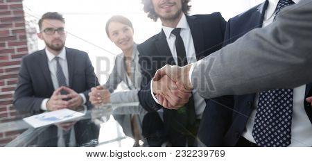 background image of handshake of business partners