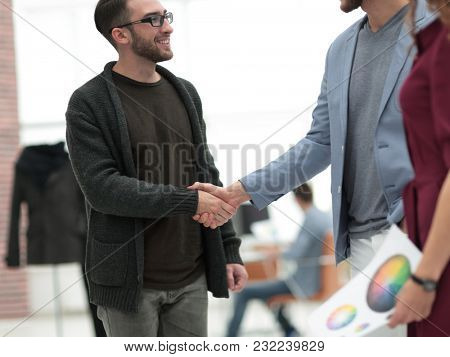 closeup.the handshake between the designer and the client