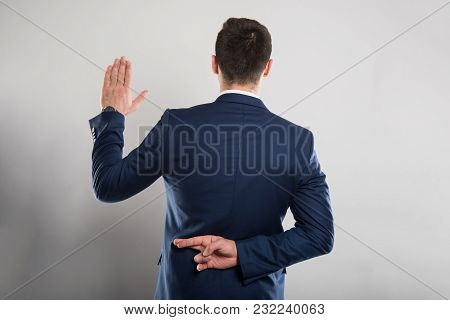 Back View Of Business Man Taking Fake Oath Gesture