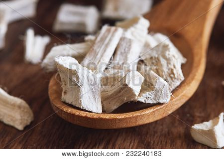 Dried And Sliced Marshmallow Root (althaea Officinalis) In Wooden Spoon