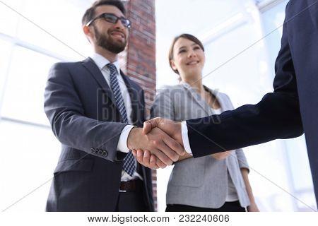 friendly handshake of business people.