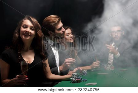 poker players with a glass of wine,sitting at the table