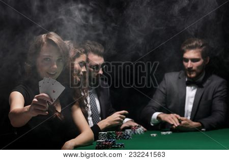 smiling woman with the winning combination of cards