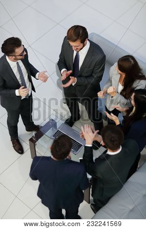 Business team high fiving in the office