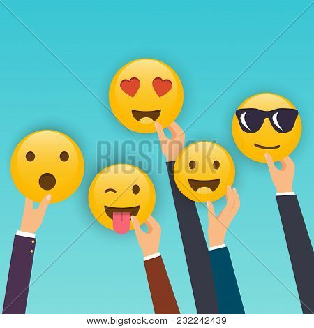 Hand Holding Reaction Smileys. Social Media Marketing Concept.