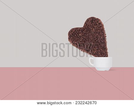 A Huge Cookie From Ground Coffee In The Form Of A Heart In A Coffee Cup On A Colorful Background