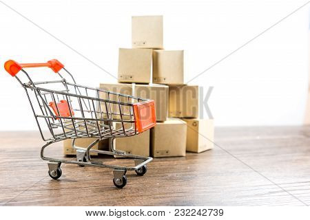 Shopping Cart And Box On Wood Table With White Background  Business Shopping , Concept Online Shoppi