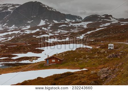 Tourism Vacation And Travel. Camper Van Motorhome On Camping Site Rest Place In Norwegian Mountains