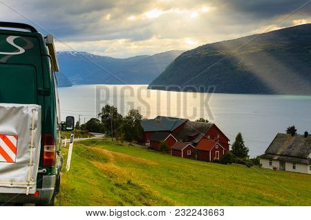 Tourism Vacation And Travel. Camper Van And Mountains Landscape Fjords In Norway Europe