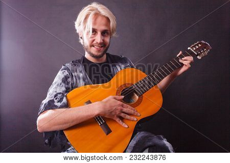 Music, Passion Concept. Young Blonde Man Smiling Wearing Fancy Shirt Playing On Acoustic Guitar, Stu